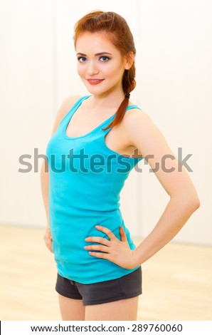 Young girl at fitness club - stock photo
