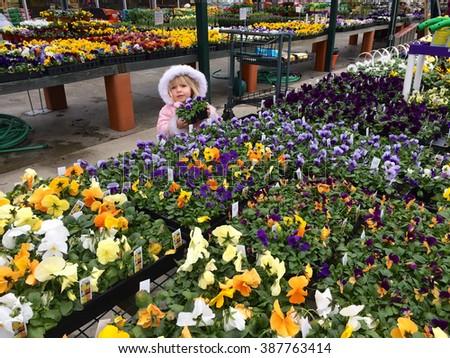 young girl at garden center - stock photo