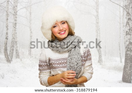 Young girl at snowy forest - stock photo