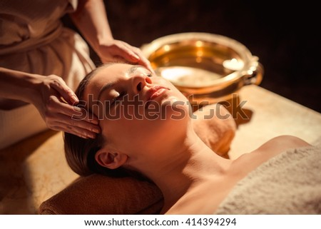 Young girl at spa massage - stock photo
