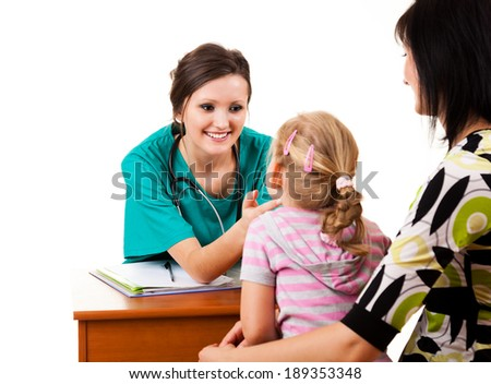 young girl at the doctor, white background - stock photo