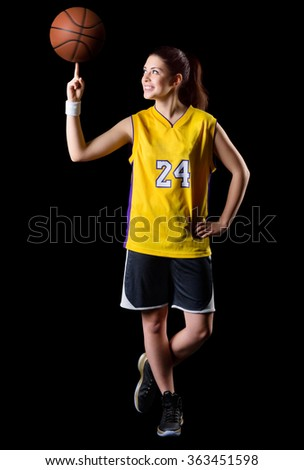Young girl basketball player isolated - stock photo