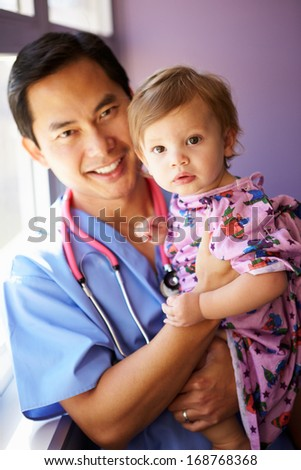 Young Girl Being Held By Male Pediatric Nurse - stock photo