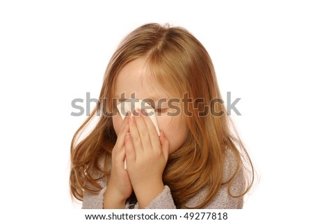 Young girl blowing her nose - stock photo
