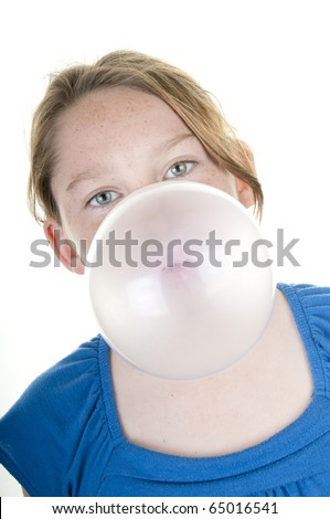 Young girl blowing huge gum bubble