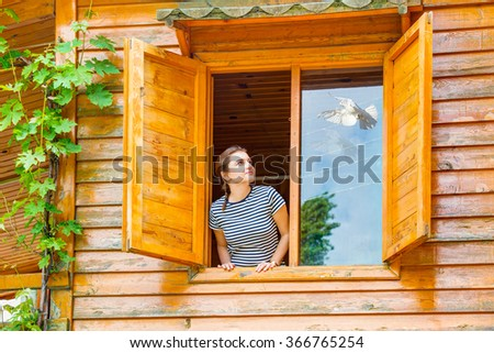 young girl breath of fresh air and white pigeon - stock photo