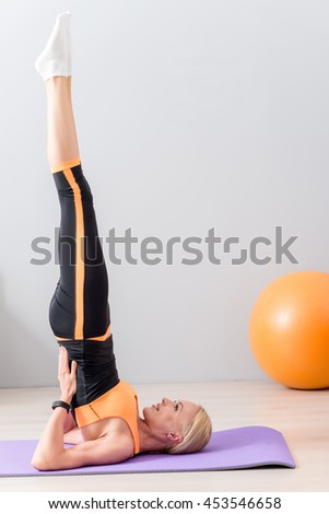 Young girl caring of her figure - stock photo