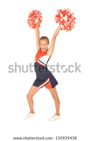 Young girl cheerleading with orange pompoms - stock photo