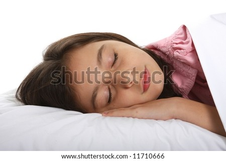young girl / child peacefully sleeping in bed