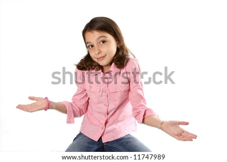 Young girl / child shrugging shoulders against white background