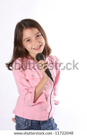 Young girl / child singing in microphone against white background