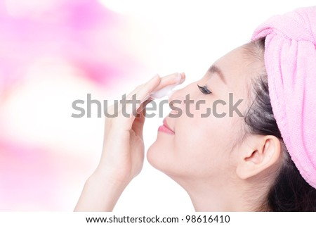 Young Girl Clean Face with foam on hand on pink background, model is a asian beauty - stock photo