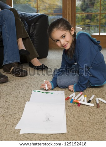 Young girl coloring with markers - stock photo