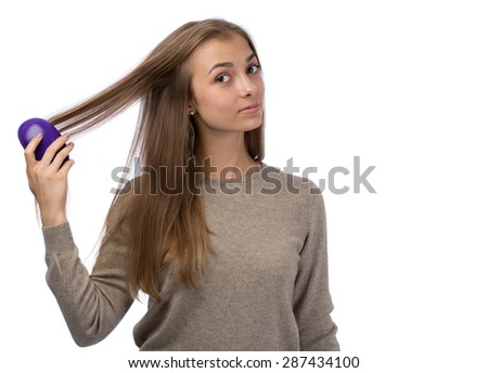 Young girl combing the studio. Isolate on white background. - stock photo