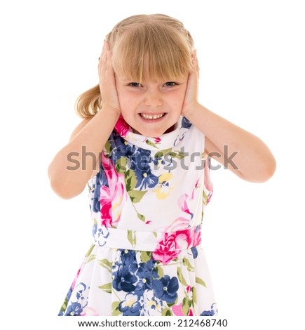 young girl covered her ears with her hands on a white background.The concept of child development, education, recreation - stock photo