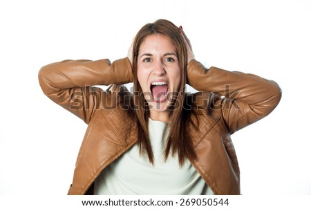 young girl covering her ears and shouting isolated on white background