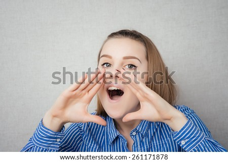 Young girl cries holds hands near the mouth - stock photo