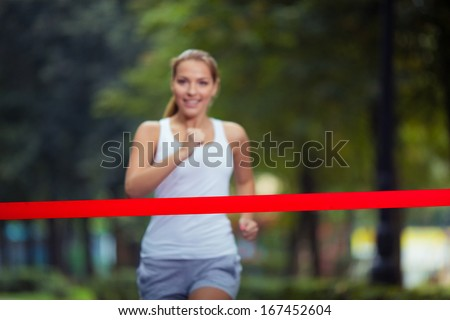 Young girl crosses finish line