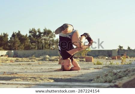 Young girl dancing break dance on the street - stock photo