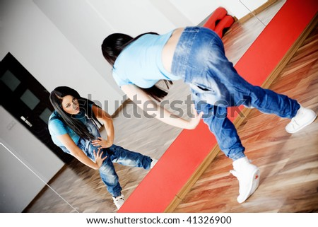 Young girl dancing in the dance club - stock photo