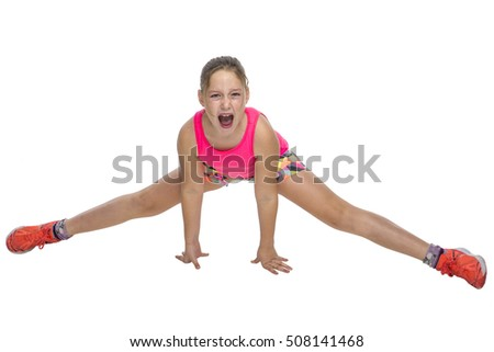 Young girl doing a painful stretching exercise on white background.