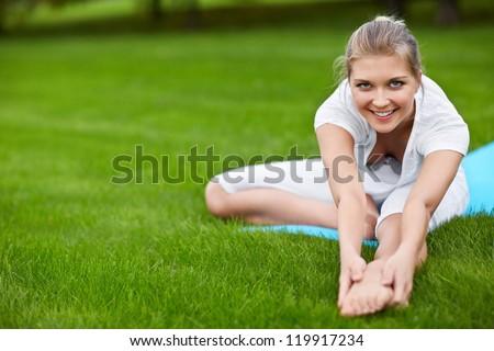 Young girl doing gymnastics outdoors - stock photo