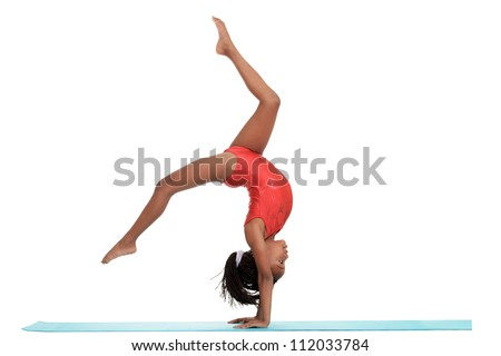 young girl doing gymnastics with motion blur - stock photo