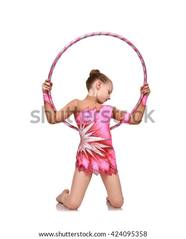 young girl doing gymnastics with pink hoop - stock photo