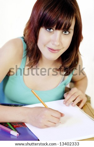 Young girl doing her homework 2