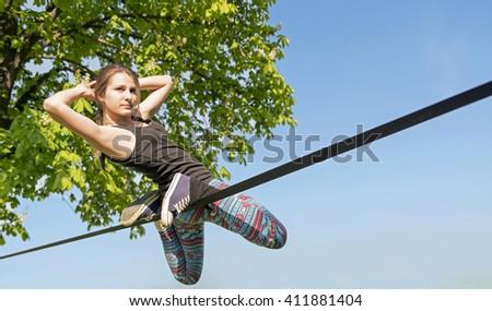 young girl doing slackline - stock photo