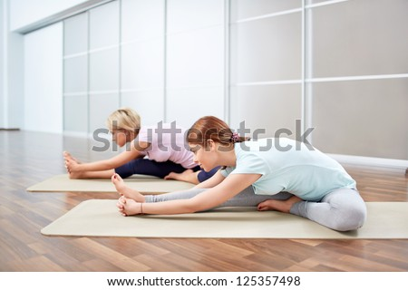 Young girl doing stretching