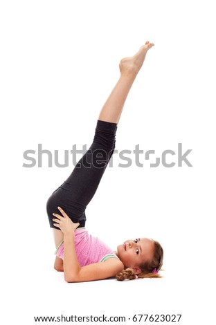 Young girl doing the candle gymnastic exercise - isolated