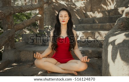 Young girl doing yoga fitness exercise outdoor in beautiful mountains landscape. Morning sunrise. Meditation and Relax.Woman practicing yoga on the beach at sunset. Yoga woman mountain peak