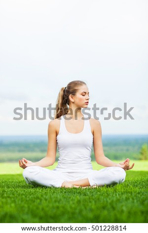 Young girl doing yoga outdoor