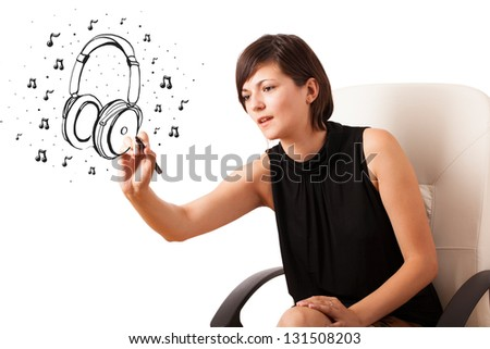 Young girl drawing headphone and musical notes isolated on white