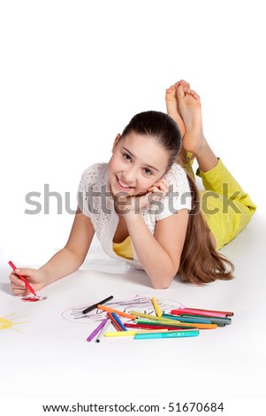 Young  girl draws a felt-tip pens