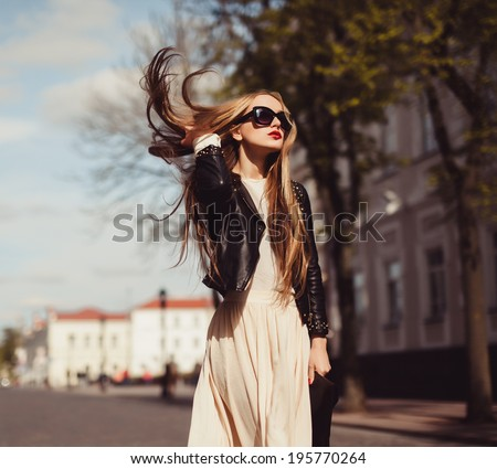 young girl dress in light air posing in the street - stock photo