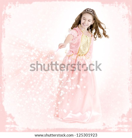 Young girl dressed as a princess with magic wand charms