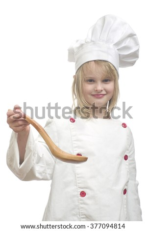Young girl dressed as chef with wooden spoon on white background. - stock photo