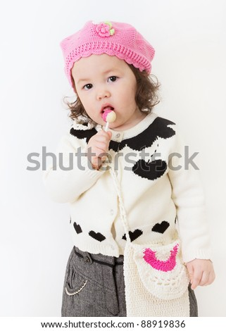 Young girl dressed fashionably in a pink hat for fall