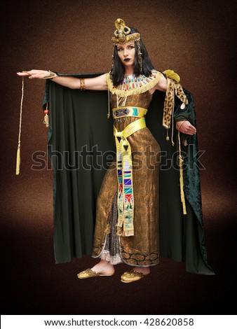 young girl dressed in Cleopatra costume, pose, studio shot, - stock photo