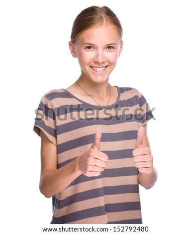 Young girl dressed in red is showing thumb up gesture using both hands, isolated over white - stock photo