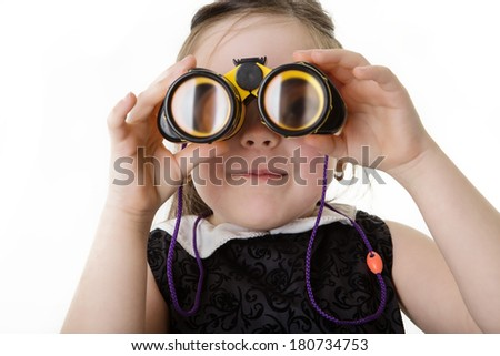 young girl dressed up in a office dress looking through toy binoculars