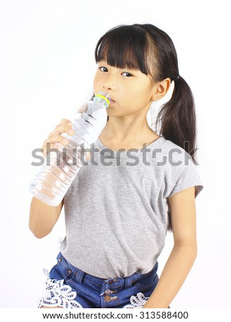 Young girl drinking fresh water from a bottle on white background - stock photo