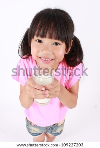 Young girl drinking milk.