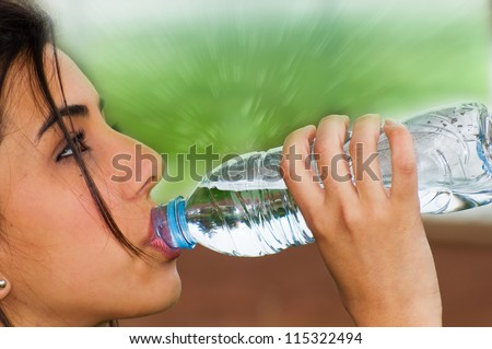 Young girl drinking water from a bottle after doing some exercise for a good health and general wellness
