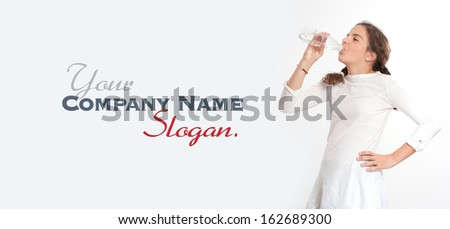 Young girl drinking water from a plastic bottle  - stock photo
