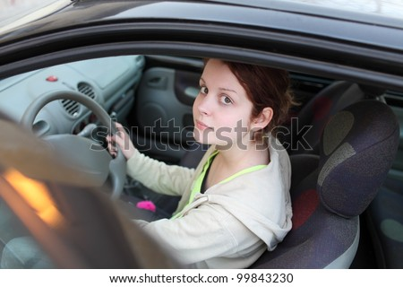 Young girl driver in a car