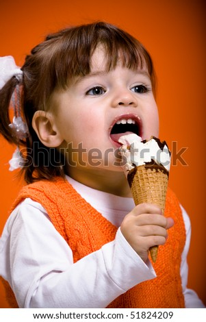 young girl eating an ice cream