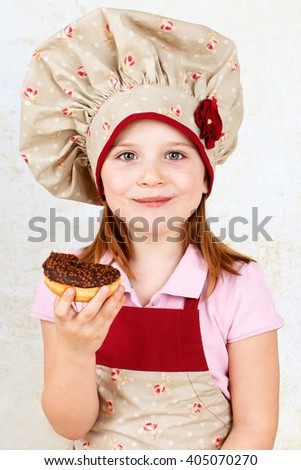 Young girl eating donut - stock photo